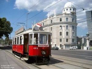 Traveling by a vintage tram in Vienna, here in front of th Urania