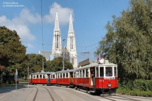 A magnificent three-car train from Rent a Bim in front of the Votive Church